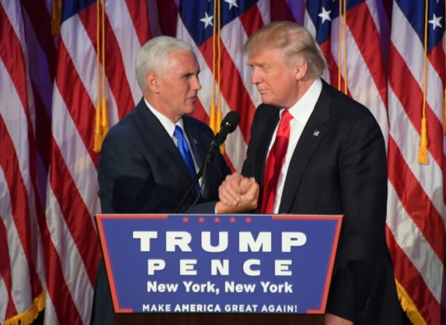Republican presidential-elect Donald Trump (right) shakes hands with vice president-elect Mike Pence during a post election party in New York, on November 9, 2016