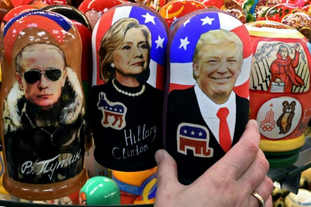 Traditional Russian Matryoshka dolls in Moscow, depict (L-R) Russian President Vladimir Putin, Hillary Clinton and US Republican president elect Donald Trump