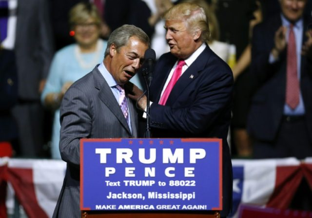 US President-elect Donald Trump greets United Kingdom Independence Party interim leader Nigel Farage during a campaign rally in Jackson, Mississippi, on August 24, 2016