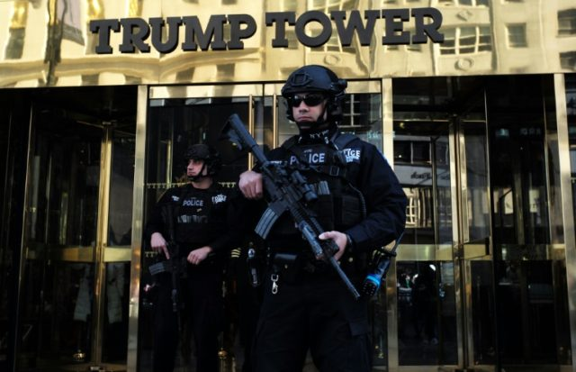 New York Police Department officers guard the main entrance of the Trump Tower on November 14, 2016