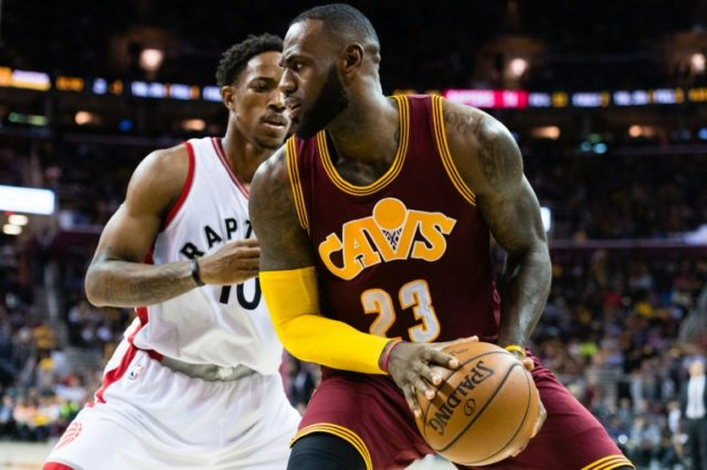 LeBron James of the Cleveland Cavaliers fights for position with Toronto's DeMar DeRozan on November 15, 2016