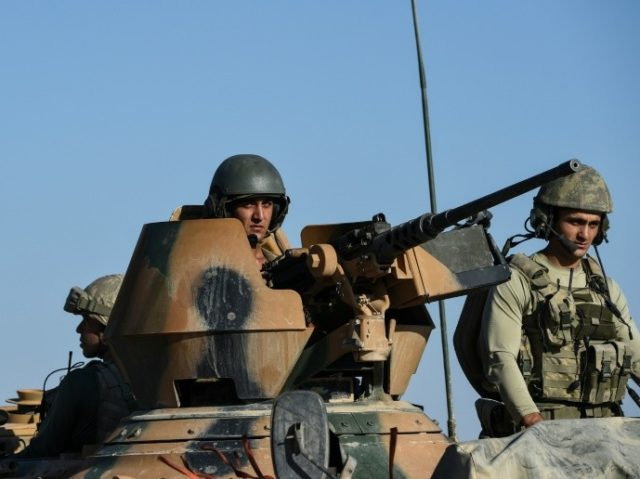 Turkish soldiers stand in a Turkish army tank driving back to Turkey from the Syrian-Turkish border town of Jarabulus on September 2, 2016 in the Turkish-Syrian border town of Karkamis