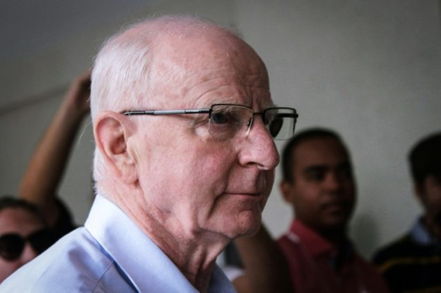 Olympic Committee of Ireland president, Patrick Hickey arrives at a police station to be questioned over alleged Olympic ticket touting, in Rio de Janeiro, Brazil, on September 6, 2016