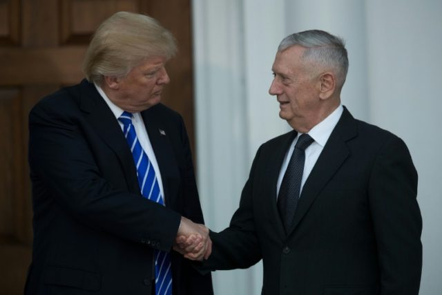 Donald Trump shakes hands with retired United States Marine Corps general James Mattis after their meeting at Trump International Golf Club, November 19, 2016 in Bedminster Township, New Jersey