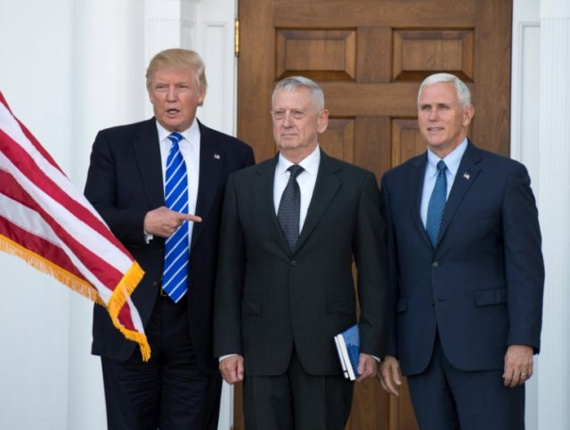 US President-elect Doanld Trump poses for a photo with MUS Marines General (Ret.) James Mattis and Vice President-elect Mike Pence on the steps of the clubhouse at Trump National Golf Club in Bedminster, New Jersey in November 19, 2016