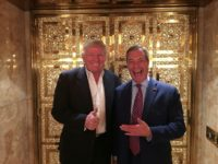 UKIP leader Nigel Farage stands with US President-elect Donald Trump during their meeting at Trump Tower in New York