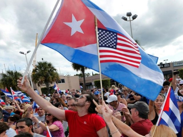 "Cuban Americans in Miami react to the death of Fidel Castro on November 26, 2016, the day before US President-elect Donald Trump's advisers said his administration would strike a ""better deal"" for for Cuba than current President Barack Obama"