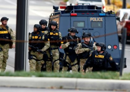 Law enforcement officials are seen outside of a parking garage on the campus of Ohio State University as they respond to an attack in Columbus, Ohio, on November 28, 2016