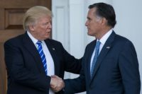 President-elect Donald Trump (L) shakes hands with Mitt Romney after their meeting at Trump International Golf Club, November 19, 2016