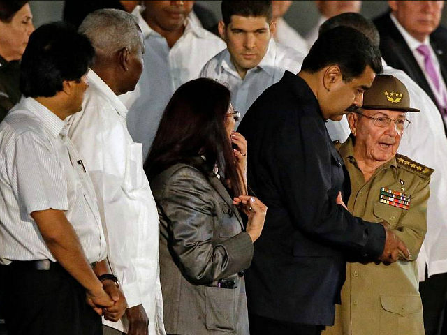 Cuba's President Raul Castro embraces Venezuela's President Nicolas Maduro waves as he arrives to a rally honoring his deceased brother Fidel Castro at the Revolution Plaza in Havana, Cuba, Tuesday, Nov. 29, 2016. Schools and government offices were closed Tuesday for a second day of homage to Fidel Castro, with the day ending in a rally on the wide plaza where the Cuban leader delivered fiery speeches to mammoth crowds in the years after he seized power. Fidel Castro passed away Friday Nov. 25. He was 90. At left Bolivia's President Evo Morales. Third from right Venezuela's First Lady Cilia Flores.(AP Photo/Ricardo Mazalan)