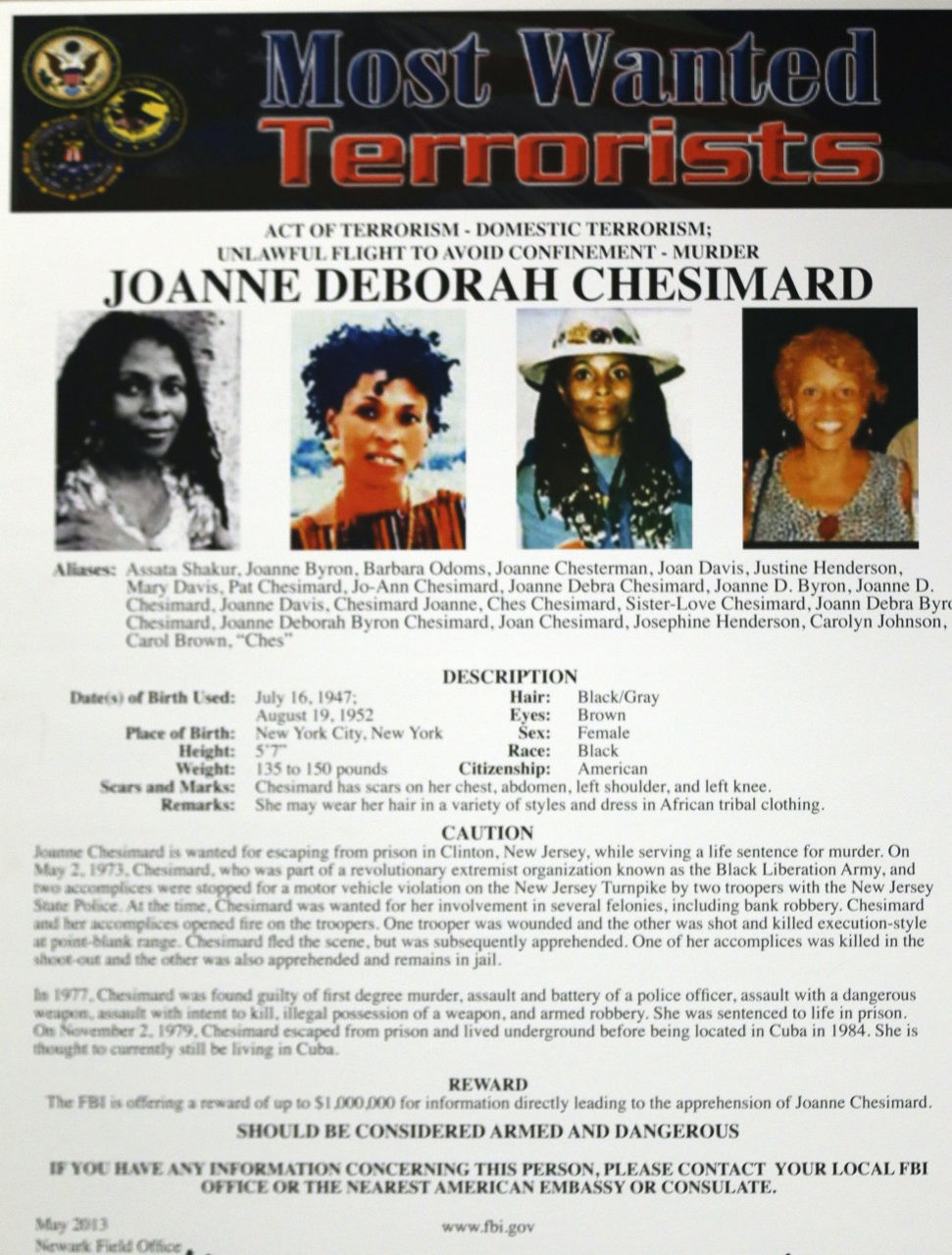 A poster with photographs of Joanne Chesimard (aka Assata Shakur), a convicted murderer and fugitive for more than 30 years, was on display during a news conference in Newark, N.J., on May 2, 2013 -- the 40th anniversary of the violent confrontation that led to the slaying of a New Jersey state trooper. The reward for her capture and return was doubled to $2 million, and the FBI made Chesimard, now living in Cuba, the first woman on its list of most wanted terrorists.  (AP Photo/Julio Cortez)
