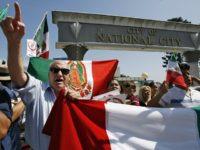 Immigrants rights activists chant during a sanctuary city rally held in National City, Calif., Saturday, Sept. 30, 2006. National City Mayor Nick Inzunza is proposing that the city become a sanctuary for illegal immigrants. A counter protest organized by the Minuteman Project drew over a hundred people opposed to the …