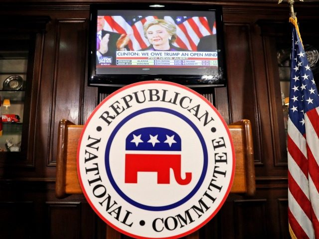 Democratic presidential candidate Hillary Clinton is seen on the television at the Republican National Committee (RNC) before a news conference about the GOP's success on Election Night, Wednesday, Nov. 9, 2016 in Washington. (AP Photo/Alex Brandon)