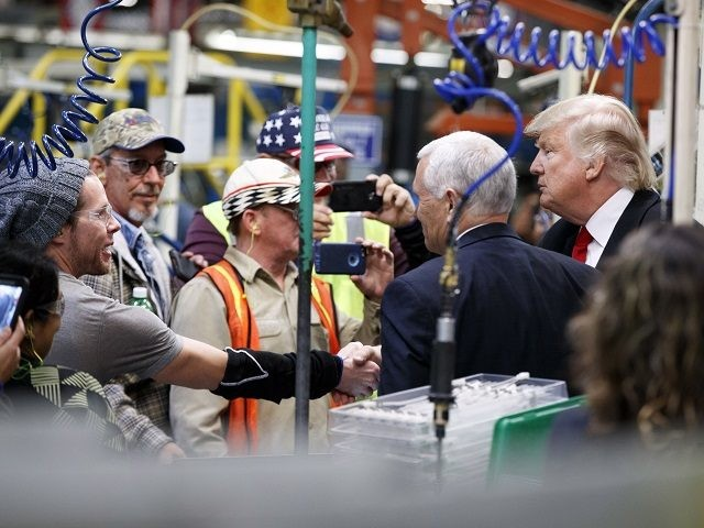 President-elect Donald Trump and Vice President-elect Mike Pence talk with factory workers during a visit to the Carrier factory, Thursday, Dec. 1, 2016, in Indianapolis, Ind. (AP Photo/Evan Vucci)