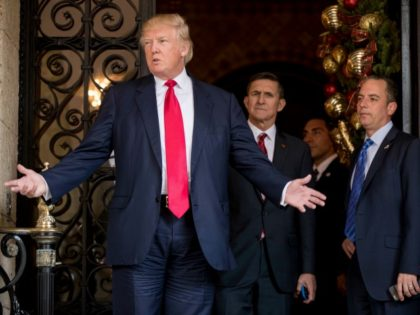 President-elect Donald Trump, left, accompanied by Trump Chief of Staff Reince Priebus, right, and Retired Gen. Michael Flynn, a senior adviser to Trump, center, speaks to members of the media at Mar-a-Lago, in Palm Beach, Fla., Wednesday, Dec. 21, 2016. ()