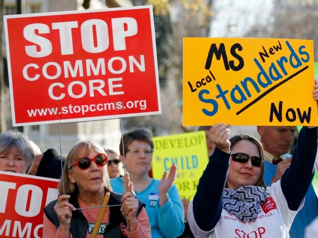 FILE - In this Jan. 6, 2015 file photo, Common Core opponents wave signs and cheer at a rally opposing Mississippi's continued use of the Common Core academic standards on the steps of the Capitol in Jackson, Miss. Results for some of the states that participated in Common Core-aligned testing …