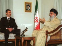 Iran's supreme leader Ayatollah Ali Khamenei (R) meets Syrian President Bashar al-Assad in Tehran 25 January 2001. Assad, on his first visit to the Islamic Republic since taking power six months ago, described the policies of the former US administration on the Middle East peace process as a failure. AFP PHOTO/Atta KENARE (Photo credit should read ATTA KENARE/AFP/Getty Images)