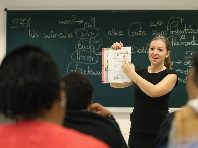 POTSDAM, GERMANY - NOVEMBER 11: Instructor Paulina Kedziora leads an intermediate German language class for migrants and refugees from countries including Eritrea, Afghanistan, Iran, Chechnya and Somalia seeking asylum in Germany at Euro-Schulen Potsdam on November 11, 2015 in Potsdam, Germany. The classes are paid for by the German Federal …