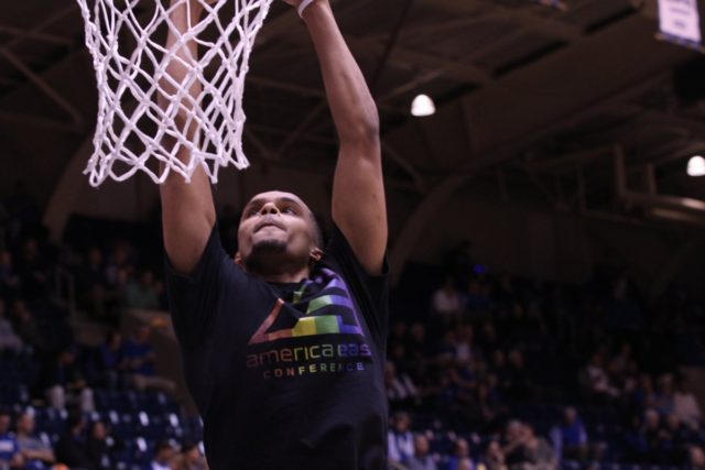 """University of Maine basketball team members wear rainbow tshirts during warmup during Saturday's game against Duke to protest North Carolina's HB2 """"bathroom law"""""""