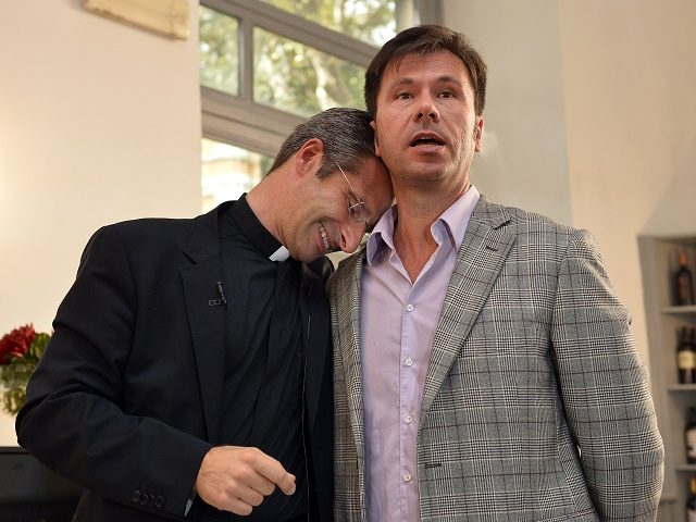 "Father Krysztof Olaf Charamsa (L), who works for a Vatican office, gives a press conference with his partner Edouard to reveal his homosexuality on October 3, 2015 in Rome. The priest said he wanted to challenge what he termed the Church's ""paranoia"" with regard to sexual minorities, claiming the Catholic …"