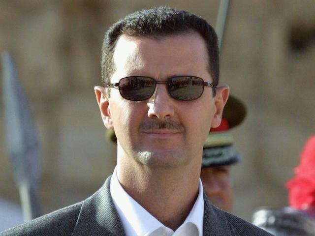 "Syrian President Bashar al-Assad is seen during an official ceremony at his palace in Damascus 20 October 2003. US President George W. Bush signed legislation 12 December 2003, that aims to punish Syria for its alleged ties to terrorists and purported efforts to obtain nuclear, biological and chemical weapons. ""Today, I have signed into law HR 1828, the 'Syria Accountability and Lebanese Sovereignty Restoration Act of 2003,'"" Bush said in a statement released by the White House. AFP PHOTO/ Louai BESHARA (Photo credit should read LOUAI BESHARA/AFP/Getty Images)"