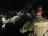 US Border Patrol agent Richard Funke patrols along the border fence between Arizona and Mexico at the town of Nogales on July 28, 2010. A federal judge blocked the most controversial parts of Arizona's new immigration law, barring police from checking the immigrant status of suspected criminals. The ruling came …