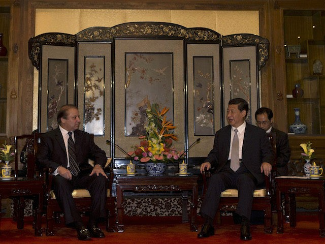 Pakistan Prime Minister Nawaz Sharif (2nd L) talks to Chinese President Xi Jinping (2nd R) as their wives, Pakistan First Lady Begum Kulsoom Nawaz Sharif (L) and Chinese first lady Peng Liyuan (R) sit during a meeting at the Diaoyutai State guest house in Beijing on July 4, 2013. Pakistan …
