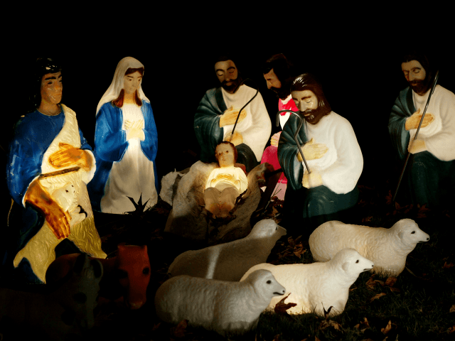 PASADENA, CA, DECEMBER 17: A life-size nativity scene glows in a yard on December 17, 2003 in Pasadena, California. Many of southern California's better holiday lights displays are in Pasadena. (Photo by David McNew/Getty Images)