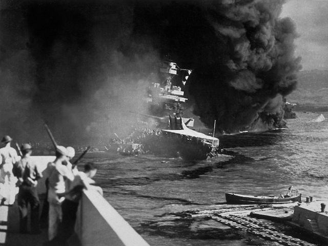 7th December 1941: The USS California on fire in Pearl Harbour (Pearl Harbor) after the Japanese attack. (Photo by Fox Photos/Getty Images)