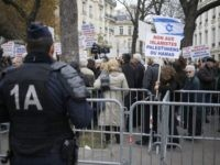 People take part in a pro-Israel demonstration urging the government not to recognise Palestine as a state, amid growing European frustration at the moribund Middle East peace process, on November 28, 2014 in front of the French National Assembly in Paris. AFP PHOTO / KENZO TRIBOUILLARD (Photo credit should read …