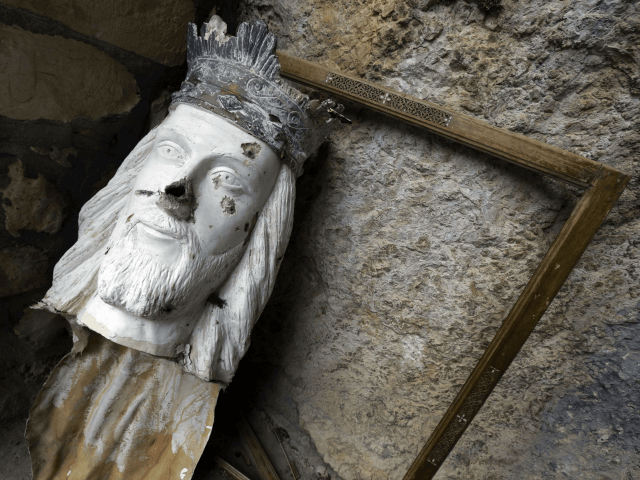A broken statue depicting Jesus Christ is seen at the monastery of Saint Takla in the ancient Christian town of Maalula, 56 kilometers northeast of the capital Damascus on May 14, 2014. Residents of Maalula returned to the historic Christian town in mid-April to mark Easter, glad that the Syrian …