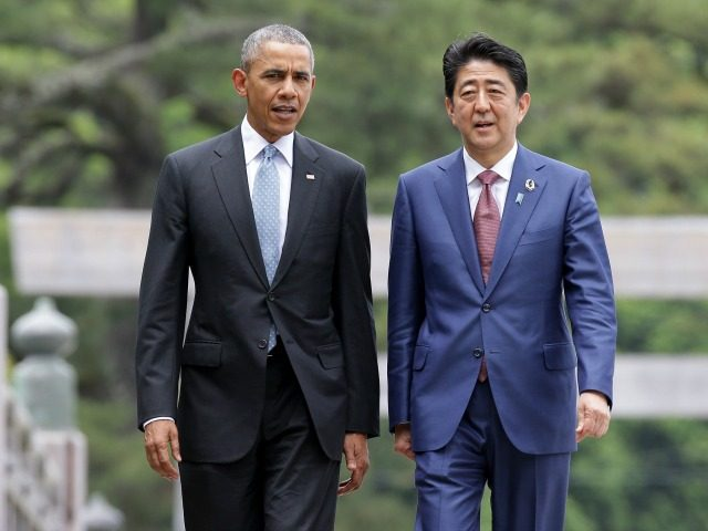 U.S. President Barack Obama walks with Japanese Prime Minister Shinzo Abe on the Ujibashi bridge as they visit at the Ise-Jingu Shrine on May 26, 2016 in Ise, Japan. In the two-day summit, the G7 leaders are scheduled to discuss global issues including counter-terrorism, energy policy, and sustainable development. (Photo …