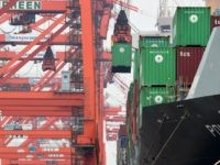 container is unloaded from an international freighter at a port in Tokyo on June 20, 2016. For May, Japan logged a deficit of 40.72 billion yen ($389 million), compared with a trade surplus of 823.18 billion yen in April, as exports of steel and semiconductors declined, the finance ministry said. …