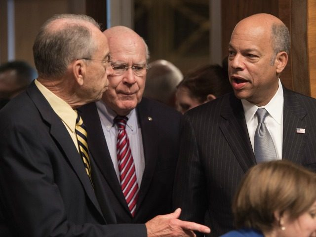 Homeland Security Secretary Jeh Johnson speaks with Senate Judiciary Committee chairman Senator Chuck Grassley of Iowa (L) and Ranking Member Senator Patrick Leahy of Vermont as he arrives to testify at a hearing on Oversight of the Department of Homeland Security on Capitol Hill in Washington, DC, on June 30, …
