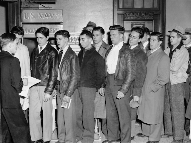 Shortly after the Japanese attack in Hawaii's Pearl Harbor, young men line up to volunteer at a Navy Recruiting station, Boston, Massachusetts, December 8, 1941. (Photo by Hulton Archive/Getty Images)