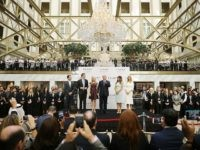 Republican presidential nominee Donald Trump (C) and his family (L-R) son Donald Trump Jr, son Eric Trump, wife Melania Trump and daughters Tiffany Trump and Ivanka Trump prepare to cut the ribbon at the new Trump International Hotel October 26, 2016 in Washington, DC. The hotel, built inside the historic …