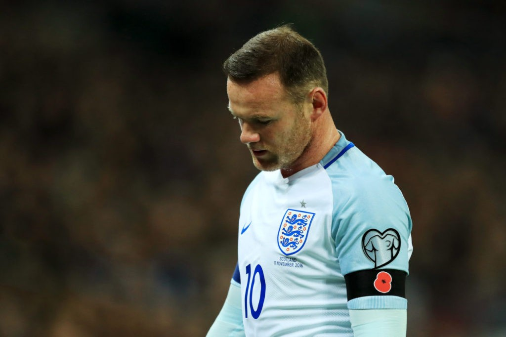 LONDON, ENGLAND - NOVEMBER 11: Wayne Rooney of England wears a Poppy black armband during the FIFA 2018 World Cup qualifying match between England and Scotland at Wembley Stadium on November 11, 2016 in London, England. (Photo by Richard Heathcote/Getty Images)