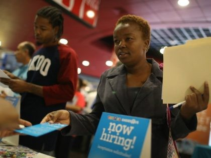 Melissa Thermidor speaks to a job recruiter for Toys'R'Us during the JobNewsUSA job fair at the BB&T Center on November 15, 2016 in Sunrise, Florida.