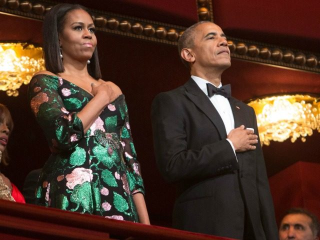 President Barack Obama and First Lady Michelle Obama stand for the National Anthem during the 2016 Kennedy Center Honors at the Kennedy Center on December 4, 2016 in Washington, DC.