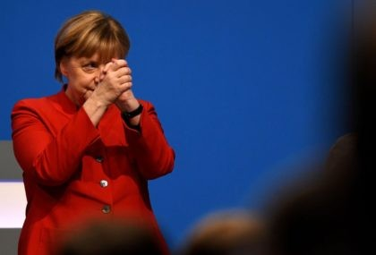 German Chancellor Angela Merkel thanks after addressing delegates during her conservative Christian Democratic Union (CDU) party's congress in Essen, western Germany, on December 6, 2016. German Chancellor Angela Merkel launches into campaign mode for elections taking place in 2017. / AFP / PATRIK STOLLARZ (Photo credit should read PATRIK STOLLARZ/AFP/Getty …