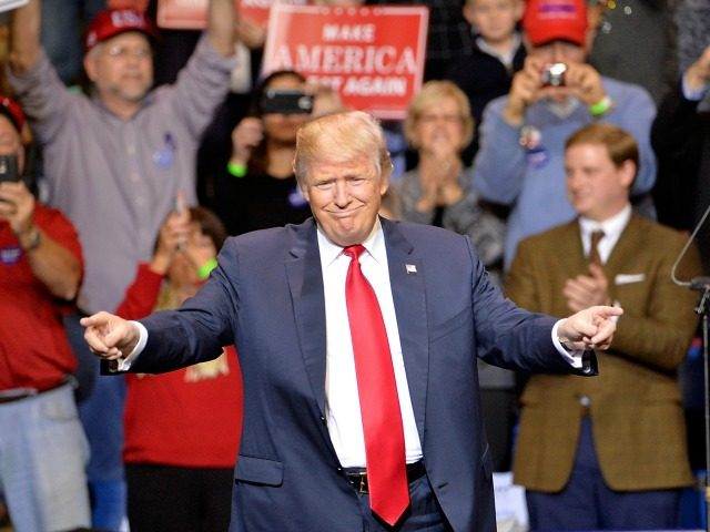 esident-elect Donald Trump points to his supporters during his 'Thank You' rally at Crown Coliseum on December 6, 2016 in Fayetteville, North Carolina. Trump took time off from selecting the cabinet for his incoming administration to celebrate his victory in the general election. (Photo by
