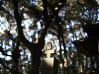 This photo taken on November 24, 2016 shows the grave of a Japanese 'hidden Christian' at Karematsu forest, where believers used to hold religious ceremonies in the city of Nagasaki. Every so often, a group in the town of Ikitsuki, near Nagasaki, meet at a local museum to recite prayers …