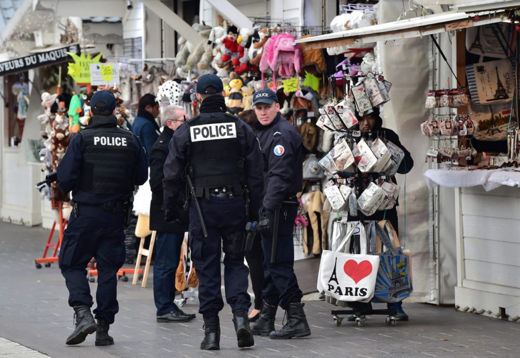"French police officers secure a Christmas market on the Champs Elysees avenue in Paris on December 20, 2016 as part of security measures in the aftermath of an attack in Berlin. French President Francois Hollande said France was under a ""high level of threat"" from terror attack following the carnage at a Berlin Christmas market. Hollande said although France faced an elevated threat, it also already had a large-scale ""security operation"" in place following a string of jihadist outrages in the country over the past two years. / AFP / CHRISTOPHE ARCHAMBAULT (Photo credit should read CHRISTOPHE ARCHAMBAULT/AFP/Getty Images)"