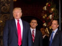 TOPSHOT - US President-elect Donald Trump (L) gestures as he speaks with Trump National Security Adviser Lt. General Michael Flynn (C) and Trump Chief of Staff Reince Priebus (R) at Mar-a-Lago in Palm Beach, Florida, where he is holding meetings on December 21, 2016. / AFP / JIM WATSON (Photo …