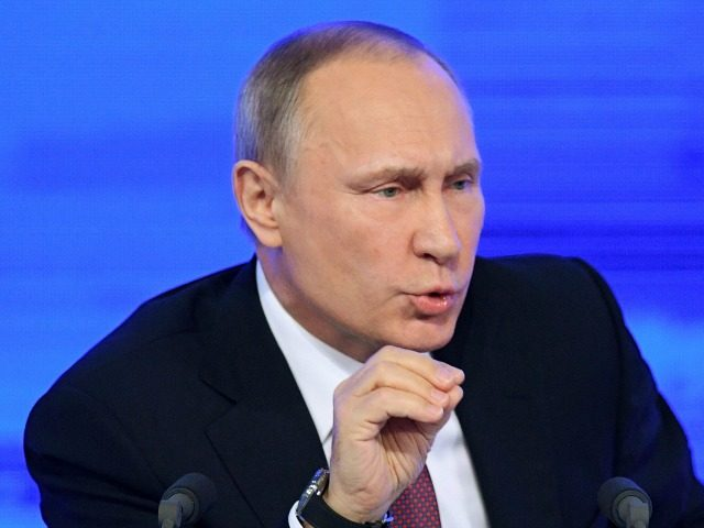 Russian President Vladimir Putin speaks during his annual press conference in Moscow on December 23, 2016. / AFP / Natalia KOLESNIKOVA (Photo credit should read