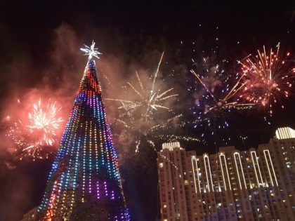 Fireworks explode next to a 38 metre Christmas tree on Christmas day at a shopping center in Jakarta on December 25, 2015. AFP PHOTO / ADEK BERRY / AFP / ADEK BERRY (Photo credit should read ADEK BERRY/AFP/Getty Images)
