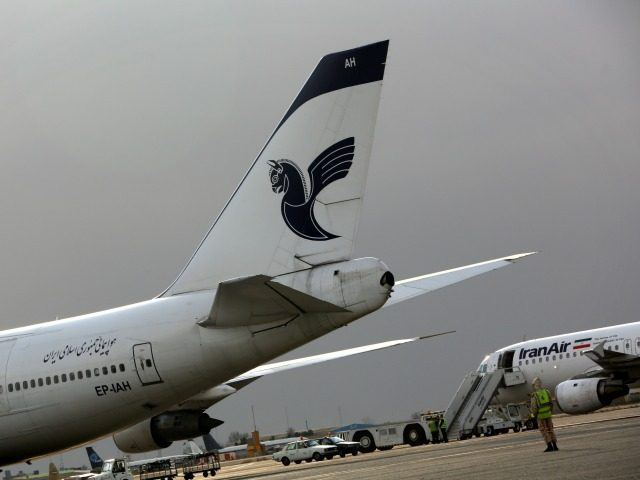 Iran Air passenger planes sit on the tarmac of the domestic Mehrabad airport in the Iranian capital Tehran on January 15, 2013. AFP PHOTO/BEHROUZ MEHRI (Photo credit should read BEHROUZ MEHRI/AFP/Getty Images)