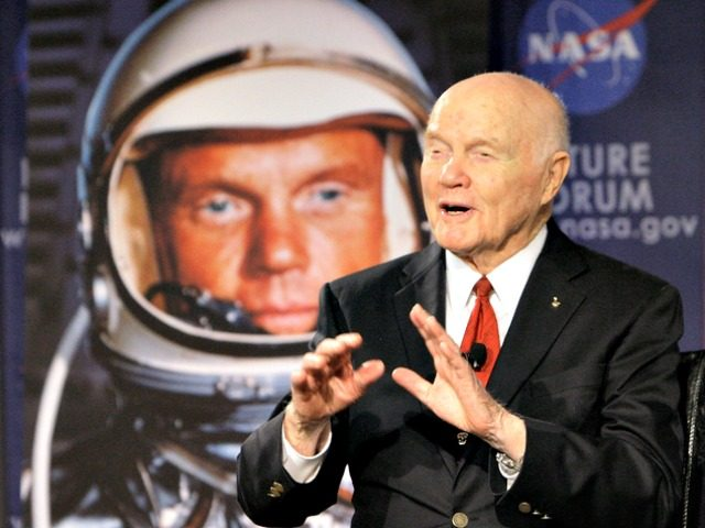 """FILE - In this Feb. 20, 2012, file photo, U.S. Sen. John Glenn talks with astronauts on the International Space Station via satellite before a discussion titled """"Learning from the Past to Innovate for the Future"""" in Columbus, Ohio. The 94-year-old former U.S. senator and his wife are scheduled to …"""