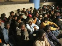 LAMPEDUSA, ITALY - JUNE 13: Illegal immigrants wait to be sent to a temporary holding centre for foreign nationals on June 13, 2005 in Lampedusa, Italy. Lampedusa Island, in the Mediterranean Sea between Malta and Tunisia, is one of the main gateways for illegal immigration from Africa into Europe. According …