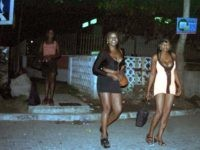 LAGOS, NIGERIA: Nigerian prostitutes wait for customers 14 October, 2000 in sexy wears at the Victoria Island district of Lagos. All over the country, large number of women work full-time or part-time in the sex trade, according to UN and human rights workers fighting the industry. (Photo credit should read …